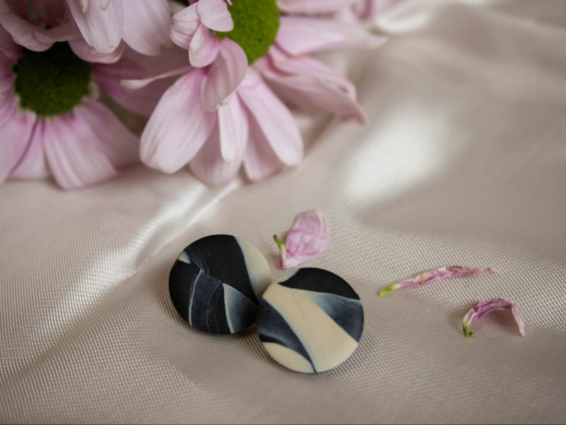 Black and beige button earrings with studs