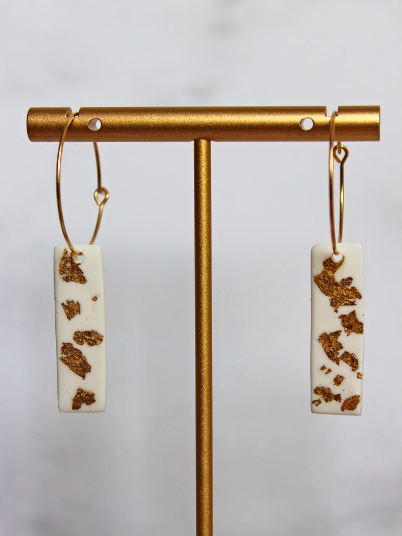 Golden Touch Earrings white with golden leaf sparkles close up