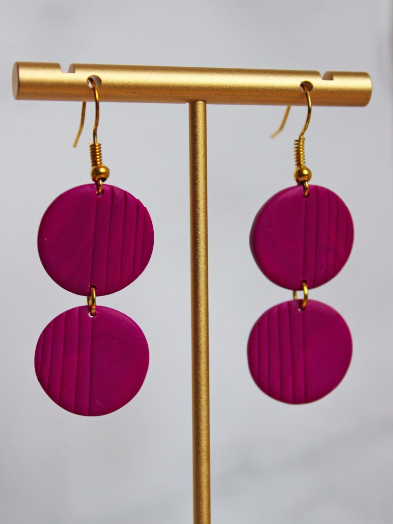Essential Magenta earrings two piece plose up photo