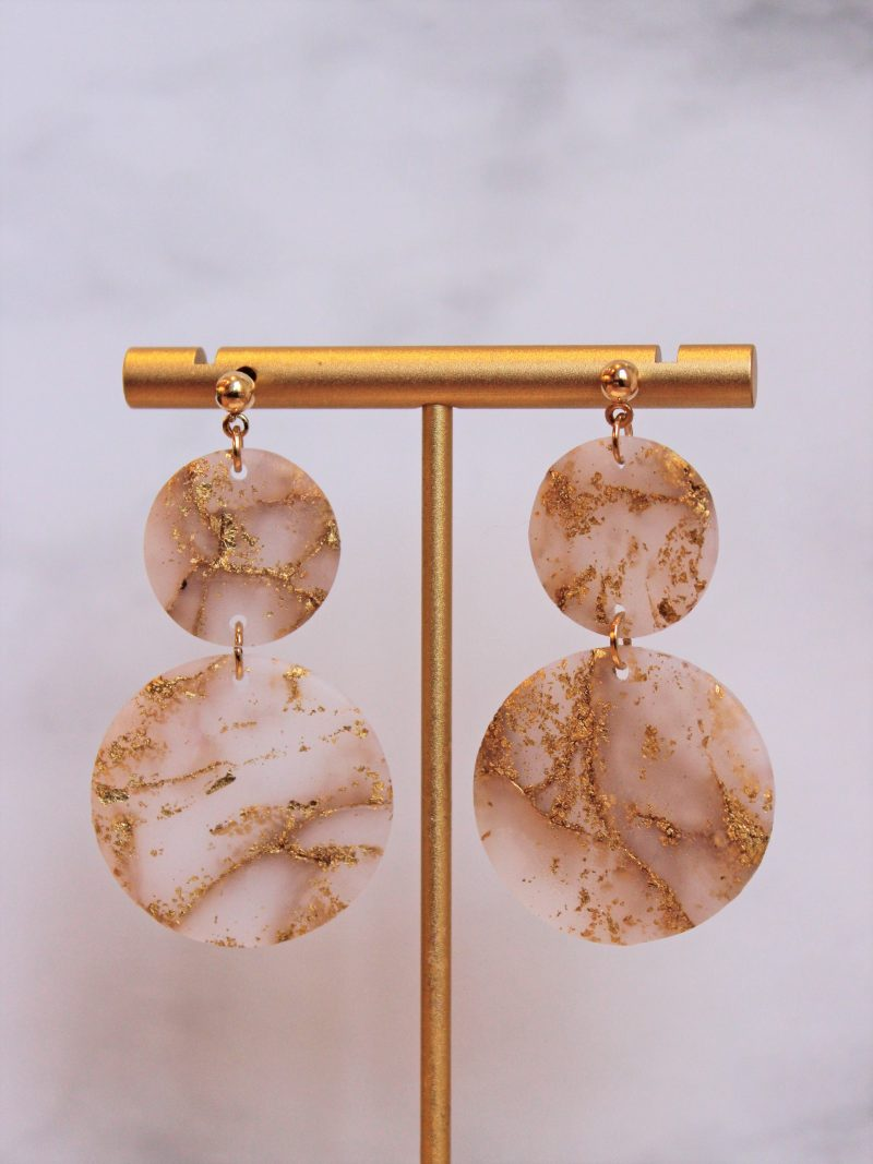 Gold Leaf marble earrings in circle shape close up